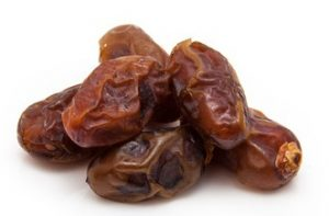 "Dried Medjool dates isolated on a white background. Medjool dates are also called ""king of dates,"" the ""diamond of dates,"" or the ""crown jewel of dates"""